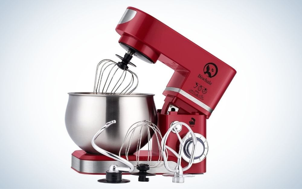 Red, stainless steel stand mixer with dough hook, wire whip, and beater