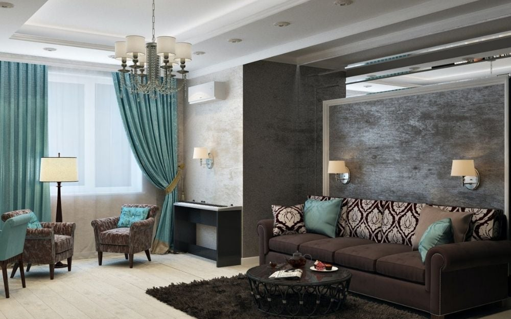 A room with a modern design with curtains in solid blue colors as well as a classic sofa in strong brown color and on both yellow lamps as well as in front of it a brown carpet with stuffing and a round brown table.