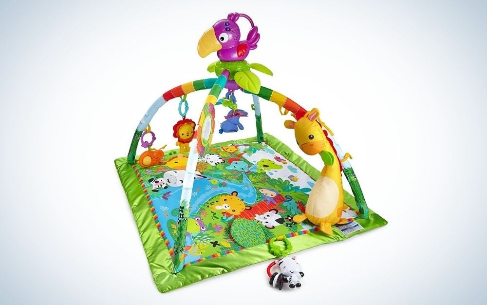 A fun game for young children with a layer from below with different figures in it and with strong green colors as well as with a series of hanging toys with three pendants from above.