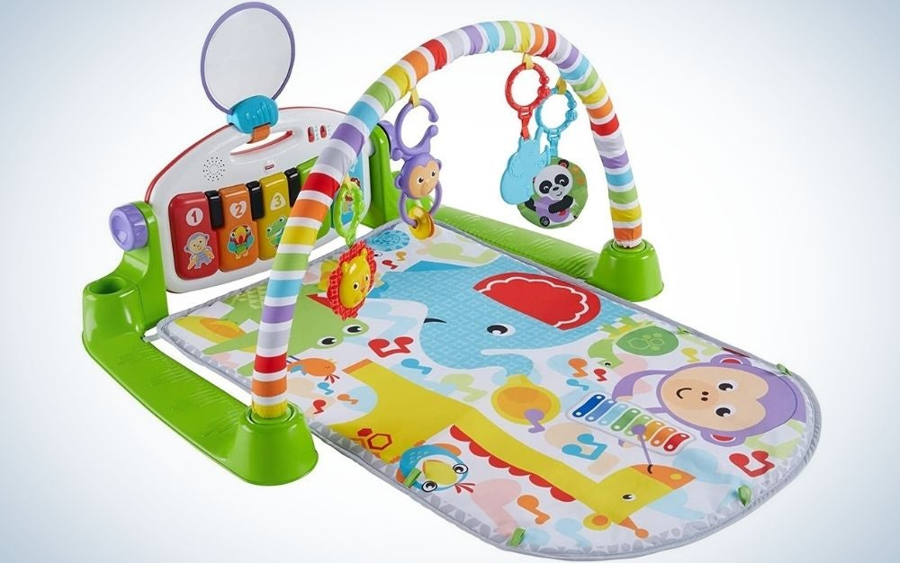 A fun game for young children with a layer from below with different figures in it and with strong green colors as well as with a series of hanging toys with one pendants from above, and on his head some colored telephones and a green plastic side stand.
