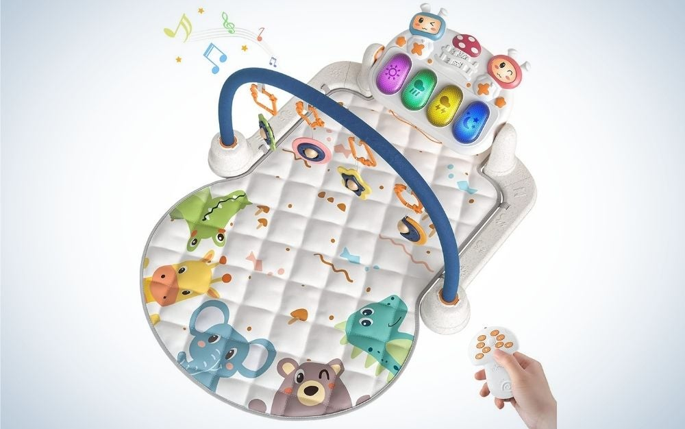 A fun game for young children with a layer from the bottom with various animal figures on it and heads with some large colored buttons as well as a series of hanging toys with a pendant from above, all in white.