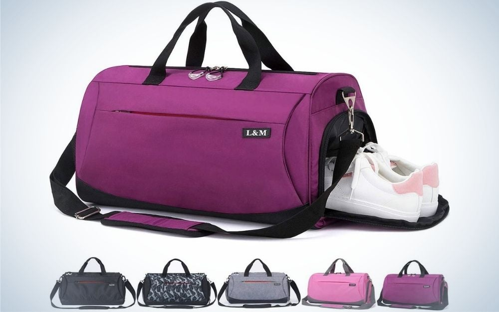 A small purple bag with two holders in the shape of belts in it and a long belt too and with the brand name on the side of it, as well as a pair of white sneakers inserted on the side of the bag, as well as under it a series of the same bags in different colors.