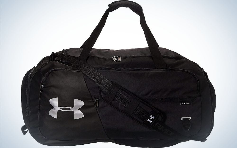 A small black bag all with a belt holder in it and the brand name on the side.