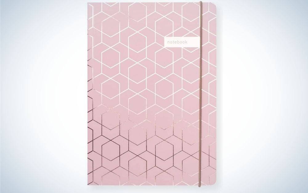 A notebook with a pink cap and some brilliant silver drawings all in a rectangular shape.
